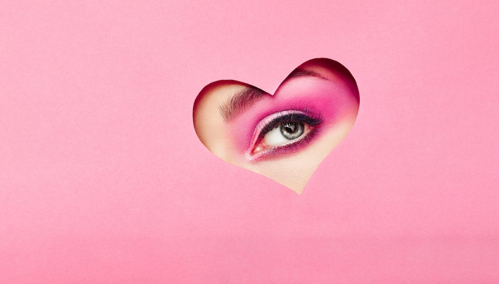 Woman with heart over eye