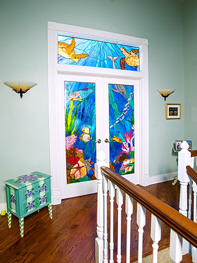 colorful stained-glass master bedroom doors