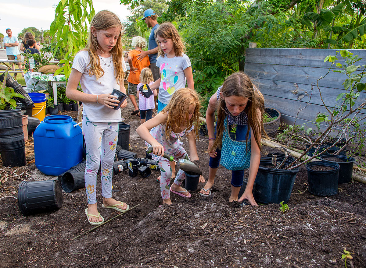 Students fill their seedling pots