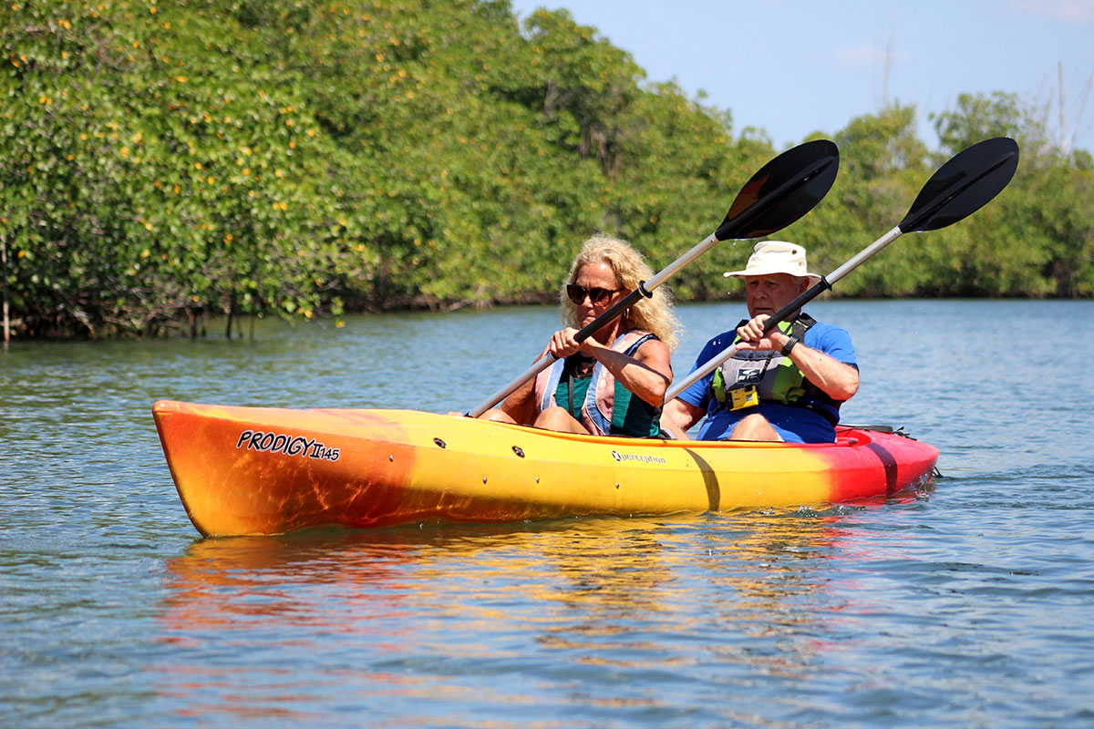 Kathy Jones and Fred Mays paddle together